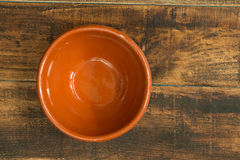 Empty bowl for the kitchen. On a wooden background Royalty Free Stock Photo