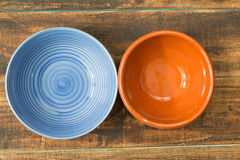 Empty bowl for the kitchen. On a wooden background Stock Images