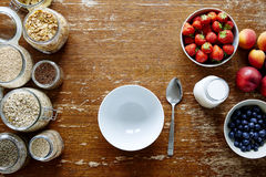 Empty bowl and rich nutrious muesli bar healthy organic cereal and fresh seasonal fruits Stock Photography