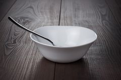 Empty bowl with spoon Royalty Free Stock Photography