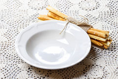 Empty bowl and traditional italian breadsticks Royalty Free Stock Photo