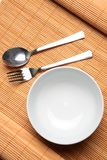 An Empty Bowl with Utensils Stock Photography