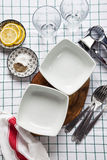 Empty bowls, glasses, cheese grater, spices. on the tablecloth. Stock Images