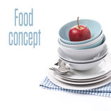 Empty bowls, plates and red apple on napkin, isolated Royalty Free Stock Photos