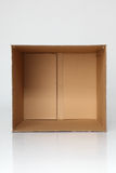Empty box. Empty brown card box open on the plain background Royalty Free Stock Photo