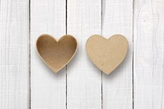 Empty box with cover in shape of heart on white wood Royalty Free Stock Image