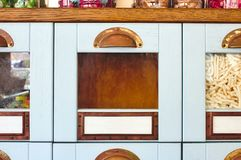 Empty box drawer with glass front in a display cabinet in a sweet shop stock photography