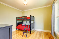 Empty boys bedroom with black bunk bed. Stock Photos
