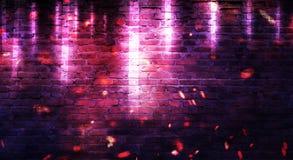 Empty brick wall background, night view, neon light, rays. Celebratory background royalty free stock photography