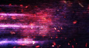 Empty brick wall background, night view, neon light, rays. Celebratory background stock photos