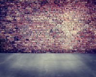 Empty Brick Wall with Concrete Floor Royalty Free Stock Images