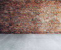 Empty Brick Wall with Concrete Floor Royalty Free Stock Photo