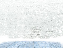 Empty brick wall with ice cover a wooden floor and snowing ,Read Stock Images