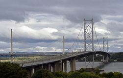 Empty bridge across the Forth river Scotland. This is the Forth road bridge that crosses the forth river in Scotland . The bridge is empty and closed to all Stock Photography