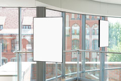 Empty bright art gallery with blank pictures on the walls Royalty Free Stock Photo
