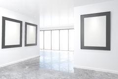 Empty bright art gallery with blank pictures on the walls, mock Royalty Free Stock Photos