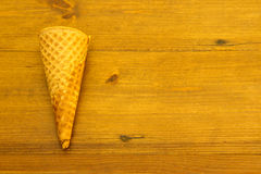 Empty brittle sugar cone on wood Royalty Free Stock Image