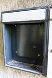 Empty broken mailbox from run down building stock photos