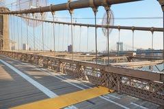 Empty Brooklyn Bridge in the morning sunlight, NY Stock Photography