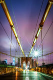 Empty Brooklyn Bridge pedestrian walkway before sunrise Royalty Free Stock Image