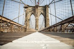 Empty Brooklyn Bridge promenade. With bike lane and pedestrian lane during summer sunny day stock photography