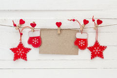 Free Empty Brown Card With Red Christmas Decorations Hanging On Cloth Royalty Free Stock Images - 80669609