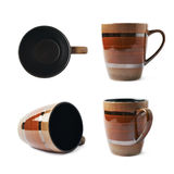 Empty brown ceramic mug. Empty brown ornamented ceramic mug  over the white background, set collection of four different foreshortenings Royalty Free Stock Photo