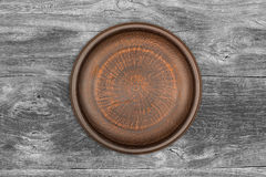Empty brown ceramic plate on rustic Stock Photo