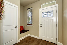 Empty brown entryway interior with white doors stock images