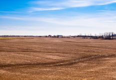 Empty brown farm fields on sky. Royalty Free Stock Photo