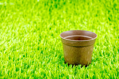 Empty brown flower pot on green grass Royalty Free Stock Image