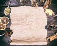 Empty brown kraft paper sheet and spices Royalty Free Stock Images