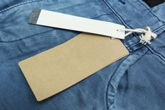 Empty brown paper tag of jean, close up.  royalty free stock photography
