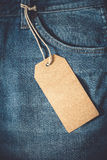 Empty brown paper tag of jean. Vintage color effect style Stock Image