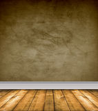 Empty Brown Room With Bare Floors. Empty grunge room with brown walls and bare wood floor Stock Photo