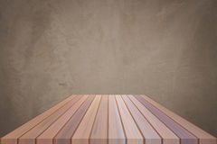 Empty brown top wooden table with concrete wall background. For product display royalty free stock photos