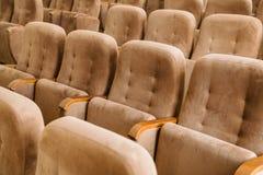 Empty brown velvet cinema seats Royalty Free Stock Image