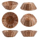 Empty brown wicker baskets at different angles on white backgrou. Empty brown wicker baskets at different angles isolated on white background Royalty Free Stock Photos