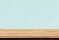 Empty brown wood table top on blue concrete background Stock Photo