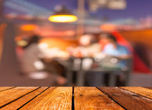 empty brown wooden table and  Coffee shop blur background with bokeh image Royalty Free Stock Photos