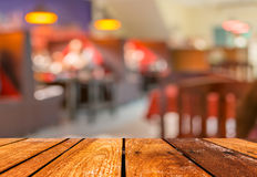 Empty brown wooden table and  Coffee shop blur background with bokeh image.  Stock Photography