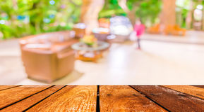 empty brown wooden table and  Coffee shop blur background with bokeh image Royalty Free Stock Images