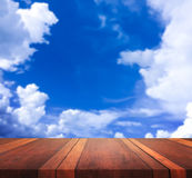 Empty brown wooden table surface and blue sky blurred background image, for product display montage,can be used for montage or dis. Play your products Stock Images