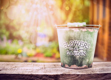 Free Empty Bucket On Old Wooden Table Over Summer Or Autumn Garden Background Stock Photography - 55674952