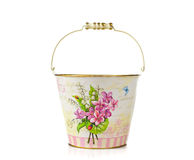 Empty bucket with vintage floral decorations. On white background Royalty Free Stock Photography