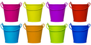 Empty buckets - colorful. Empty metal colorful buckets isolated on white stock photography