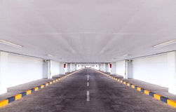 Empty building tunnel indoor lane with yellow and black stripe s stock photography