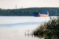 Free Empty Bulk Carrier Cargo Ship With Sailing On A River Calm Water Royalty Free Stock Image - 183408666