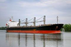Empty Bulk Freight Cargo Ship Sailing on River Stock Photos