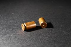 Empty bullet shell casings, on a black background, smoke.  Royalty Free Stock Photos